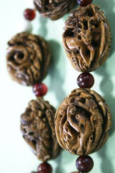 Fruit stones. Carved Chinese peach pit beads.