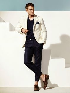 Shop this look on Lookastic: http://lookastic.com/men/looks/v-neck-t-shirt-pocket-square-blazer-dress-pants-loafers/9855 — Navy V-neck T-shirt — Navy Pocket Square — White Blazer — Navy Dress Pants — Dark Brown Leather Loafers