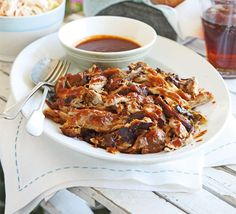 BBQ pulled pork sandwich: Slow cook pork shoulder for four hours in the oven to tenderise then finish on a BBQ. Serve with a thick, tangy sauce