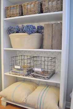 Crates. Great idea for laundry room shelves!