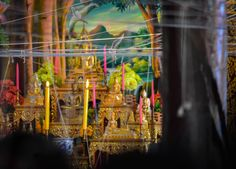 String intertwined around temple, altar and Buddha statue of the prayer hall during Songkran. Monk Blessed String Bracelets in Thailand (Sai Sin Sacred Thread). String blessed by monks to bring good luck and protection. Traditions and Culture in rural Thailand (Isaan) by http://potatoinrice.com/