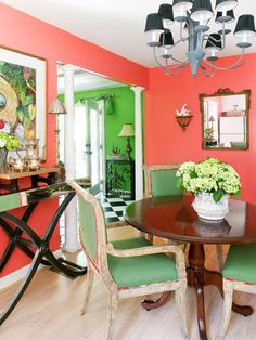 Bold Color Scheme: Coral + Green    (example of tying colour schemes together across various living spaces)