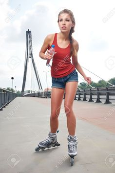 https://previews.123rf.com/images/zoomteam/zoomteam1306/zoomteam130600209/20382347-Young-woman-on-roller-skates-Stock-Photo.jpg