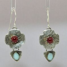 Midnight blue or aqua? Your choice of carnelian and lapis or carnelian and amazonite earrings. Both pairs feature lovely stones sitting on uniquely patterned sterling silver. The ear wires are argentium silver, a low tarnish sterling. The earrings are finished with a light patina to