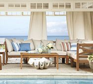 Create an outdoor room by the pool with curtains and a pretty seating arrangement for drinks by the pool.