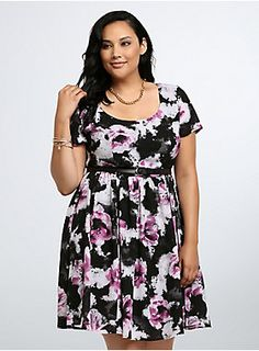 "<p>Pretty as a picture (literally), this short sleeved skater dress is splashed with a watercolor-inspired purple floral print. The black chiffon keeps the super-sweet look breezy, a black faux leather belt cinches the moving and grooving design.</p>  <p> </p>  <p><b>Model is 5'10"", size 1</b></p>  <ul> 	<li>Size 14 measures 41 1/4"" from shoulder</li> 	<li>Polyester</li> 	<li>Wash cold, line dry</li> 	<li>Imported plus size dress</li> </ul>"