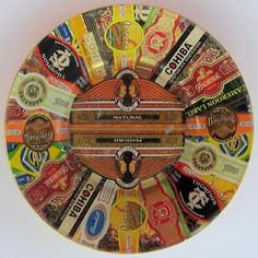 Decoupage cigar bands to glass plate
