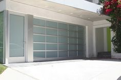 Glass Garage Doors-- polycarbonate, lexan, no fiberglass. It will help with keeping plants in garage to purify air Garage Doors Prices, Garage Door Styles, Garage Door Design, Glass Garage Door, Overhead Garage Door, Wood Garage Doors, Garage Door Insulation, Garage Door Repair, Car Garage