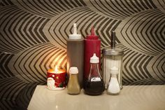 IIf you have a creative imagination, an ironic humour and squint just a little, there is a sort of art involved here: a single Santa candle juxtaposed with condiment bottles creates a still life worthy of the working-class photography of Tony Ray-Jones or Martin Parr.