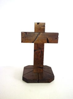 Handcarved stained wood Cross on base on Etsy, $15.00