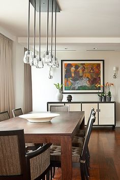 ♥ Click to see the incredible bathroom in this home - you wouldn't want to miss it! #lightfixture #diningroom #table #chair #homeinspiration #design #decor