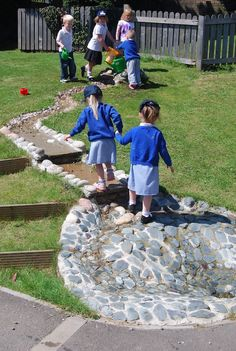 Play streams support children's communication and cooperative skills. What better way to work together than when filling buckets or paddling up the stream? Landscaped water play stream with waterfall steps and paddling pool. Preschool Playground, Kids Indoor Playground, Natural Playground, Playground Ideas, Eyfs Outdoor Area, Outdoor Play Areas, Outdoor Fun, Sand Play, Water Play