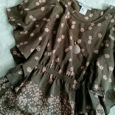 """Sale HP NWOT Cherry Blossom silk top """"Think spring"""" in this cherry blossom silk top from Paul and Joe Sister.  Cocoa brown with soft pink flowers. Elegant flowy sleeves (full coverage on sides) and peplum waist.  Never worn!!  Necklace not included. Paul and Joe Sister Tops Blouses"""
