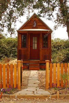 12 year old builds tiny house out of recycled material for school project. How cool is that?