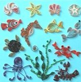 """Quilled Creations Under the Sea Kit @ Custom Quilling Supplies - Learn to make a clown fish, sea horse, yellow tang, octopus, lobster, sand dollar, shells, an adorable crab and more! The kit includes a huge assortment of bright colors (150 strips and 1/8"""" wide)."""
