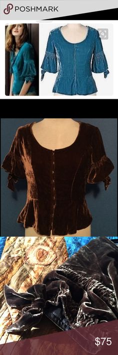 "RARE Odille Brown Queen Mary Blouse A luscious, velvet, fitted, and gorgeous top (some have called it ""jacket,"" others, ""cape"") from Odille for Anthropologie in 2005... Exactly the statement piece you need to up your medieval queen vibes as you go adventuring through castles  Slightly stretchy and sumptuously comfortable. A rich, deep chocolate color with eyelet clasps, ever so slight peplum flare, and intricate sleeves with subtle bows. Anthropologie Tops Blouses"