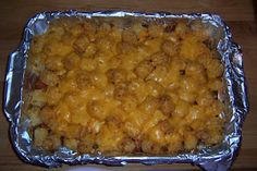 Baked bean & tots casserole from What's Cooking!: 28-oz. can of baked beans, 6-8 hot dogs (cut up), 4 cups of frozen tater tots, and 1 cup cheddar cheese. Layer & bake at 450 degrees in the oven.