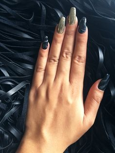 Black marble and chrome metallic nails for new year's celebration