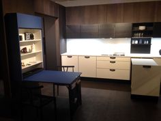HTH Kitchen - Athena black oak with white surface. Learher handles. Blue folding table Table ID.