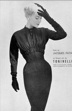 1954 Stella in black wool dress by Jacques Fath, photo by Pottier,