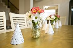 Simple, yet lovely party table centerpiece: glittered mason jar vase with flowers!