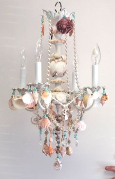 crystal and shell chandelier embellished witih seashells; beach cottage style home decor, lighting, fixture; lamp; Upcycle, Recycle, Salvage, diy, thrift, flea, repurpose!  For vintage ideas and goods shop at Estate ReSale & ReDesign, Bonita Springs, FL