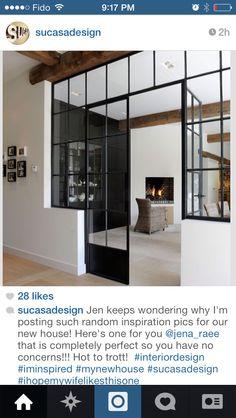 Beams, iron doors, black wall, paneling, white washed floors, white walls