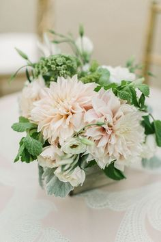 Blush and Green Dahlia Centerpieces on Patterned Ankara Table Linens | Matt Edge…