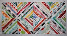 My next selvage quilt, for sure. The black/white unifying strip down the center of each block just MAKES this quilt happen! Lollyquiltz: Save the Selvage