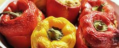 An image of cooked Greek style stuffed peppers in a dish.