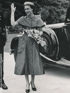 https://flic.kr/p/nd12ss | Princess Margaret on school visit | DATE:May 25 1953 D:Princess Margaret waves to pupils,who cheered her, as she left school at Weston-super-Mare after a visit to the school /original photo