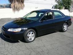 1998 Honda Accord EX. When Honda introduced its newest generation Accord, we decided to upgrade. The EX had all the power goodies and had more room than our '94 model. A very nice car. Ours was dark blue. 2.3 liter, 140 hp engine.
