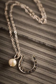 Lucky Horseshoe Necklace on BourbonandBoots.com #horseshoe #jewelry #pearls