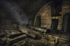 an old abandoned crypt full of mostly empty coffins Did everyone just get up and decide to leave???