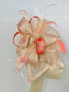 Nude & Coral Pink Sinamay Fascinator with feathers and satin headband Perfect Piece for a wedding, tea party or any other special occasion. -Ready to ship! -Available in different colors -light and airy -Comfortable and easy to wear Matching mini Mommy & Me pieces available for
