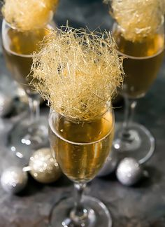 Champagne cocktails topped with homemade spun sugar. Perfectfor New Year's Eve, wedding or engagement party, or any other fancy celebratory occasion. No candy thermometer needed! Happy New Year's everyone! I made these Gold Champagne Cocktails with Spun Sugar for New Year's Eve. I really love how they turned out! They look a little bit like …