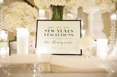 New Year's Resolution Sign | Photography: Rob and Wynter Photography. Read More:  http://www.insideweddings.com/weddings/mlb-players-white-black-gold-nye-ballroom-wedding-in-atlanta/806/