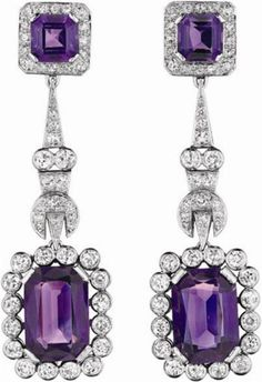 A Pair of Diamond and Amethyst Ear Pendants  Each suspending a rectangular-cut amethyst, within a collet-set circular-cut diamond surround, to the pavé-set diamond links and square-cut amethyst and pavé-set diamond surmount, mounted in platinum and 18K yellow gold, length 2 1/8 inches.