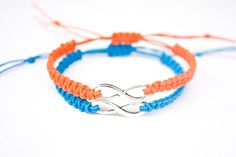 Orange and Blue Infinity Bracelets This listing is for 2 infinity friendship or couples bracelets. These are made of orange and blue hemp or cotton cord. At the center of the bracelets are an antique
