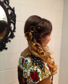 Formal style side swept look with balayage.