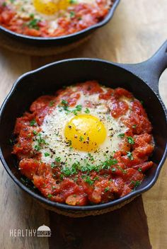 Shakshuka - eggs poached in a spicy tomato sauce. It's delicious, healthy and very filling.