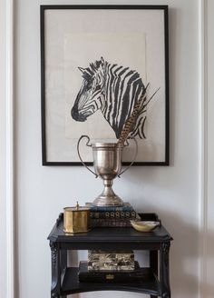 Zebra– as pattern and art motif– is a frequent sight chez Carollo. | Lonny