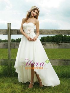 Strapless soft sweetheart of vertical pleated tulle, beaded lace accents this midriff, with tulle high low hem line, sweep train, detachable satin bias band belt with flowers. $265.00