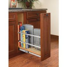 Rev-A-Shelf�5-in W x 22.44-in D x 19.50-in H 1-Tier Wood Pull Out Cabinet Basket Cabinet beside the sink.