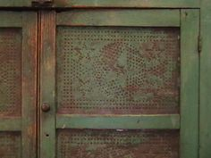 green punched tin pie safe