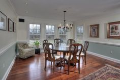 Traditional Dining Room with Chair rail, Chandelier, Hardwood floors, Crown molding