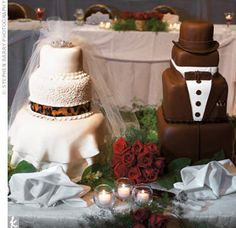 """The groom's cake had three chocolate-covered tiers and was decorated with a tuxedo, leopard handkerchief, and a top hat. """"The cakes were a huge hit and delicious,"""" Deanne says. """"I remember everyone taking pictures of them."""""""