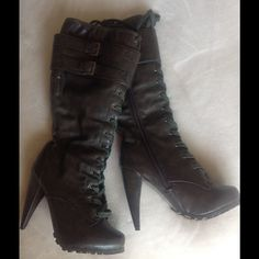 Lace up heeled combat style boots Brown almost knee high boots. Very comfy. Would fit a 6 and 6.5 with thin socks. New never stepped on. About 3.5 to 4 inch heels Shoes Heeled Boots
