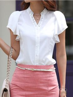 white blouse with flowy sleeves, salmon skirt with thin belt