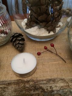 """Collected pine cones and picked red berries at the pond... Used salt and flour as """"snow"""" and recycled glass jars from old candles #merrychristmas #christmas #centerpiece #decoration #diy #doityourself #designonadime"""